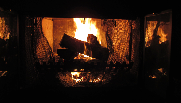 Wide View of a Roaring Fire by TheStockWarehouse