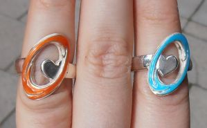 Still Alive Portal engagement rings finished by fairyfrog