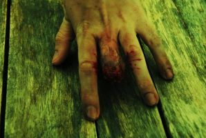 Severed finger by DeZombieShop