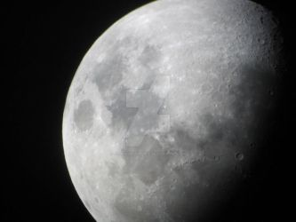 The moon through a telescope by JasonYoungdale