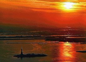 Sunset over Statue of Liberty by SamSpruce