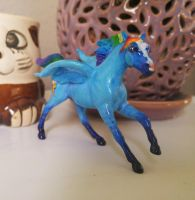 Breyer repaint and sculpted rainbow dash by QueenAnneka