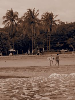 Surfers in sepia by Headwig