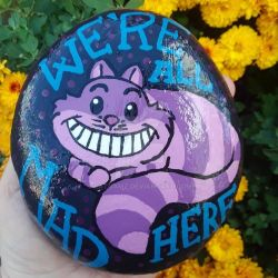 Cheshire Cat painted rock  by Batnamz