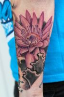 lotus flower forearm tattoo by graynd
