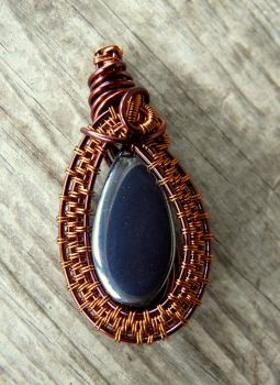 Wire wrapped pendant with hematite by Naldor