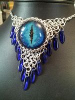 Deep blue eye in chainmaille with blue daggers by BacktoEarthCreations