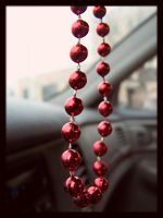 Red beads by Blackmoon90