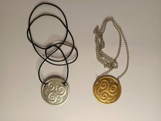 Swirly gold-silver piece necklaces by Do-Mo