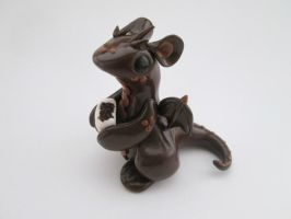 Dragon with a Chocolate truffle by KriannaCrafts