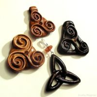 Triskalion - hand carved wooden pendants by AmberSculpture
