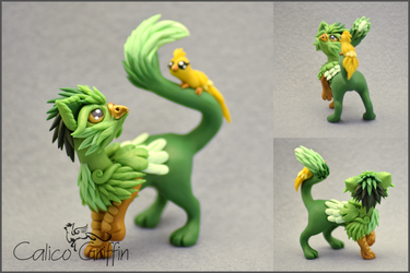 Suzumi the griffin with a bird pet by CalicoGriffin