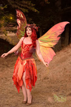 Fire Fairy with Giant Clarion Wings Leaning Back by FaeryAzarelle