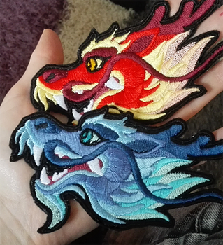Blue and red dragon head patches by goiku