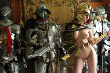 Nude female warrior with knights by HotMedievalBabes