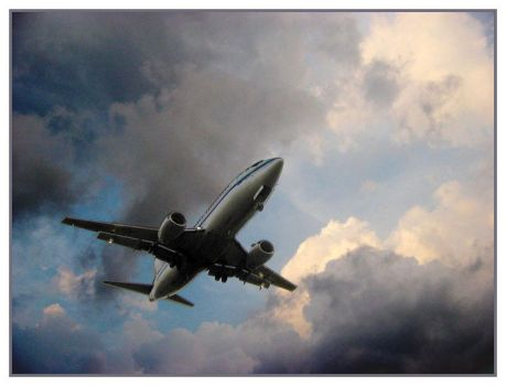 airplane with clouds by pwg