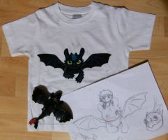 toothless baby t-shirt by minihumanoid