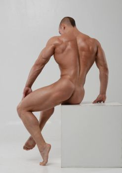 Stock nude man on cube by vishstudio