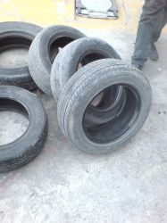 Stack of old tyres by safi-safi-safi