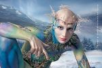 Snow queen bodypaint kneel mountain by Bodypaintingbycatdot