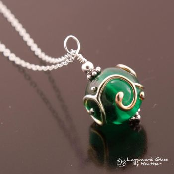 Metallic Scrolls Green Pendant by booga119