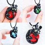 Tiny Toothless Pendants by HowManyDragons