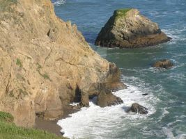 California Rocks And Cave On Coast by seancfinnigan