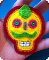 skully brooch by thetinylittlegirl