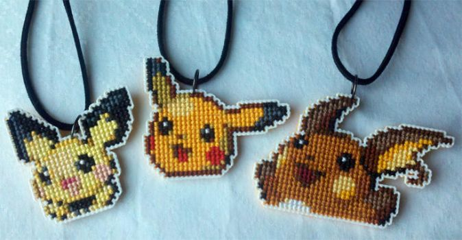 Pikachu Evolution necklaces by starrley