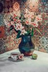 still life with flowers and a teacup by Skayka