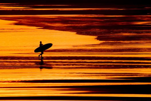 Surfer at Sunset by PonderStibbons