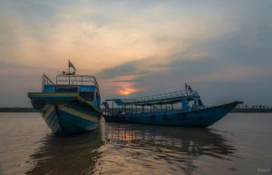 Khmer Imperium - sunset on the Mekong by Rikitza