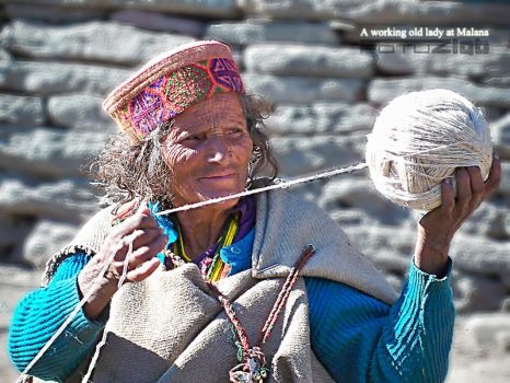 a working old lady at malana by fotuzlab