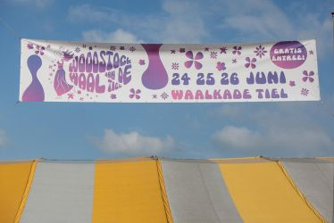 Woodstock festival banner with flowers by ISOStock