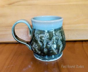 Hand Thrown Green Axolotl Themed Ceramic Mug by pixelboundstudios