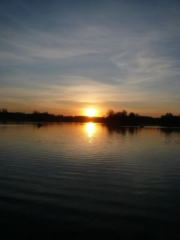 Sunset over a lake by piratas