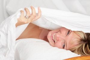 Woman in Bed Smiling by Spanishalex