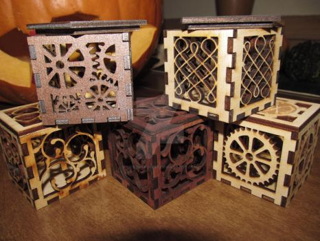 Family of art cut-out boxes by MercuryCrest