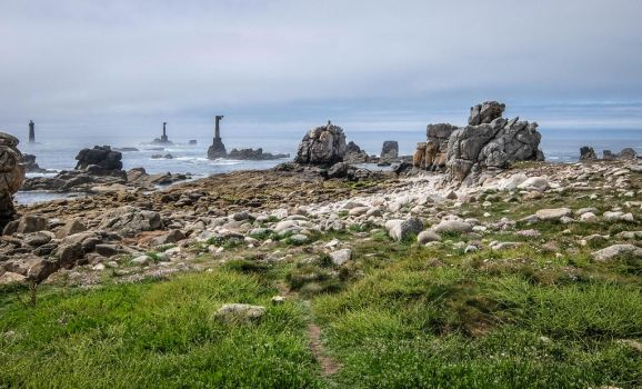 Ouessant Island 07 - Seaside Rocks and Lighthouse by HermitCrabStock