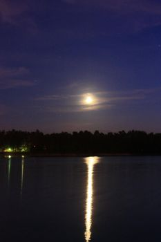 Moon over Ostrowskie Lake v2 by hutuu