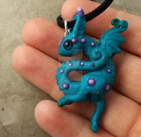 Little dancing  dragon polymer clay pendant by carmendee