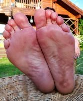 relaxing my feet in the evening sun 4 by Netsrot1971