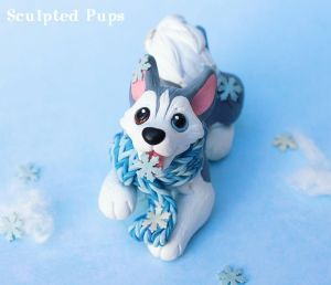Husky catching snowflakes sculpture by SculptedPups