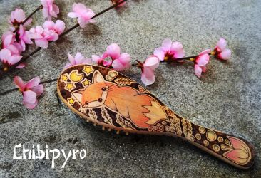 Wooden hairbrush painted by ChibiPyro