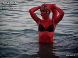 Red twi'lek hunted splashing in the sea by TwilekParadise