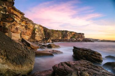 Coogee Beach cliff face by jaydoncabe
