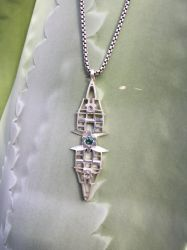 tourmaline and montana sapphire in silver by redgalacticdragon