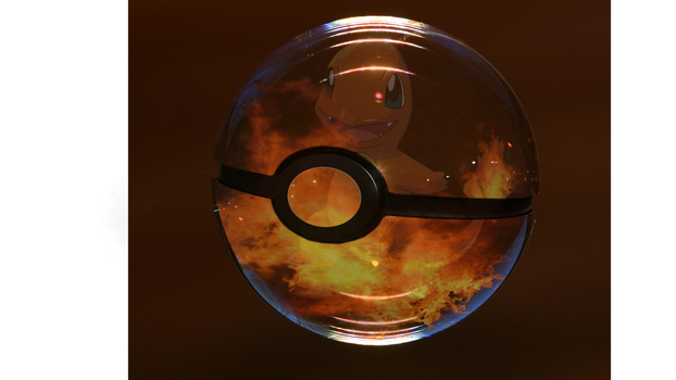 Charmander in Pokeball by dizzkitty