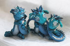 Silver and Turquoise Dragons by BittyBiteyOnes