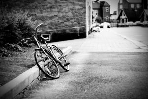 A lonely bike by WrappedUpInBooks